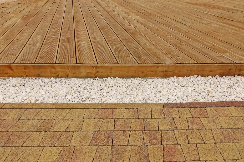 Composite Wood Decking, White Marble Gravel And Stone Brick Pavi, Backyard Dry Patio Or Terrace Surface In Perspective View.
